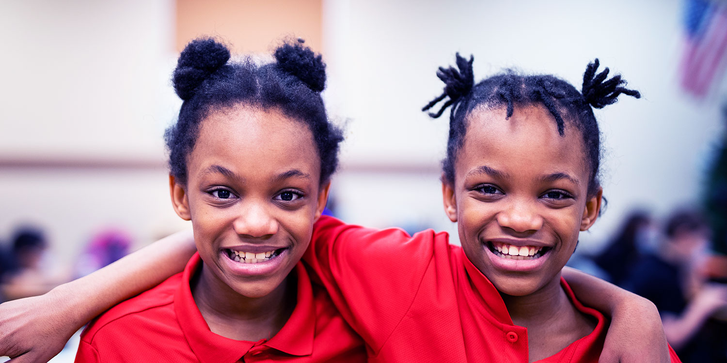 Smiling elementary students.